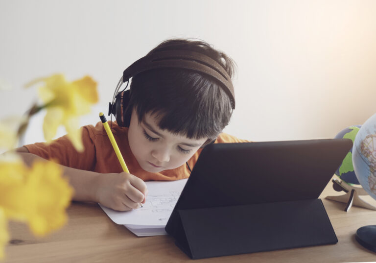 Child doing homework online